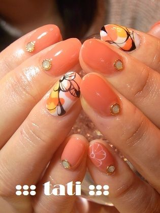 I like the printed nails...I don't know about those gem things though