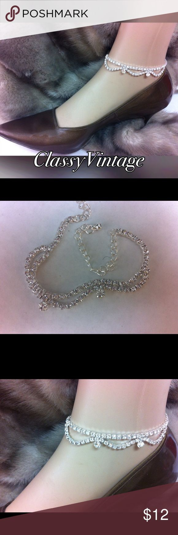 Elegant silver and diamond ankle bracelet So pretty and elegant silver colored metal and glass chrystals. Total length is 11 inches end to end. Decor length is almost 6 inches with draping half loops and two accent stones. Lobster claw clasp boutique Jewelry Bracelets