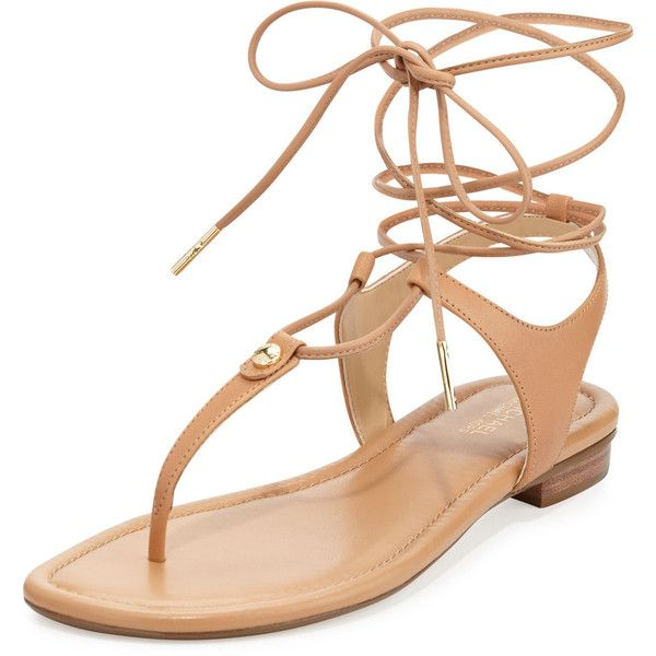 Michael Michael Kors Sofia Gladiator Flat Thong Sandal (45,775 KRW) ❤ liked on Polyvore featuring shoes, sandals, flats, suntan, roman sandals, lace up flats, leather gladiator sandals, studded gladiator sandals and leather flats