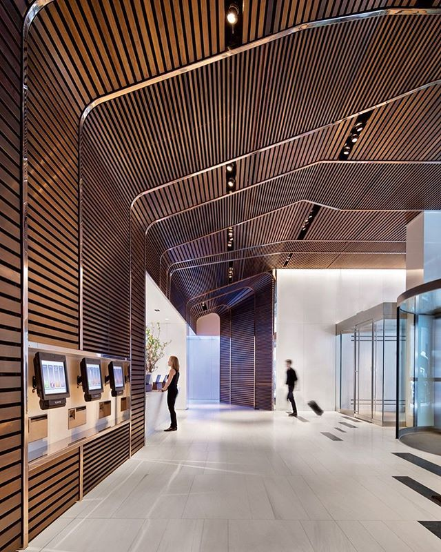 Walnut slats framed with bronze set the tone at the Hyatt Times Square New York by SPAN Architecture. 📸: Michael Moran/OTTO. @sandow #architecture #interior design #interiordesign #hotel #hyatt #walnut #lobby #newyork #nyc #manhattan
