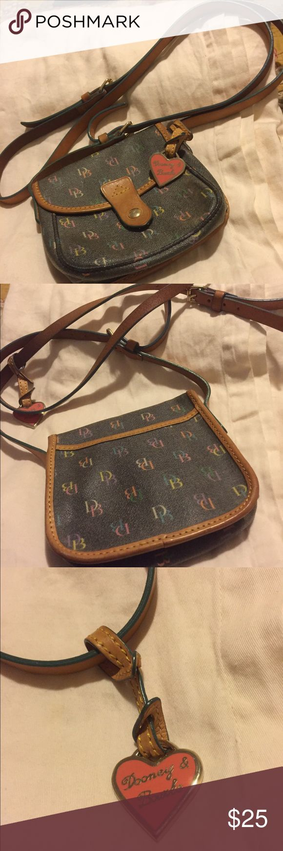 Dooney & Bourke mini shoulder bag. Dooney & Bourke mini shoulder bag. Snap closure. Outside pocket on the back side of bag. Dooney & Bourke Bags Mini Bags
