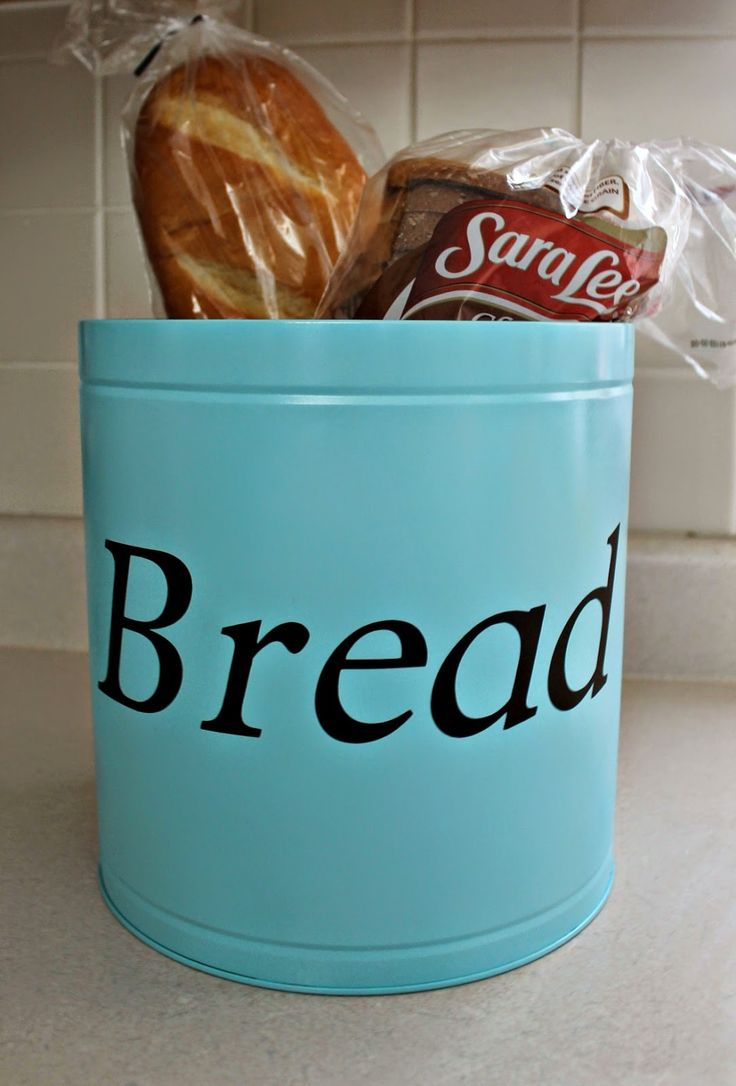 Use an old popcorn tin to make a place to store bread and keep your counter clear. Easy repurposing project. Bread tin instead of a bread box.