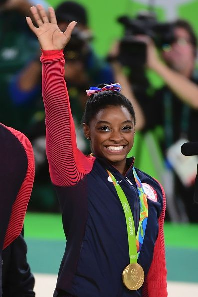 #RIO2016 US gymnast Simone Biles celebrates on the podium during the women's team final Artistic Gymnastics at the Olympic Arena during the Rio 2016 Olympic...