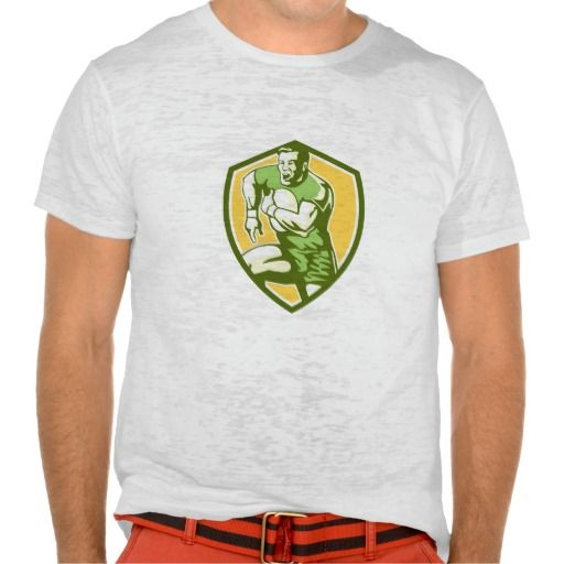 Rugby Player Running Goose Steps Shield Retro Tee Shirt. Illustration of a rugby player holding ball running goose steps charging set inside shield crest on isolated background done in retro style. #Illustration #RugbyPlayerRunningGooseSteps #rwc #rwc2015 #rugbyworldcup