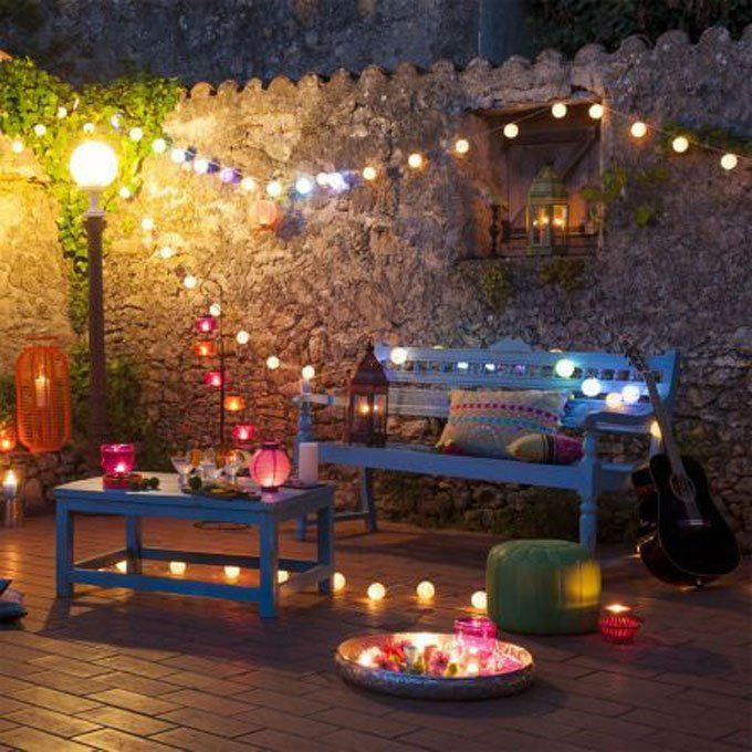 Street lamp, cozy feel, overhead string lights, mix of color
