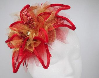Ready To Ship Red Christmas Fascinator Red Poinsettia Flower Fascinator Ugly Christmas Sweater Party Hat Holiday Fascinator Christmas Hat FREE USA SHIPPING!!!  Wired, Posible fabric flower petals!  Free First Class shipping through USPS to the USA.  ***Please review my polices regarding customs/shipping/refunds/returns/cancels*** https://www.etsy.com/shop/HatHiveHoney#policies  Check out my Facebook page for ideas in the works, free giveaways, and more! https://www.facebook.com/hathivehoney…