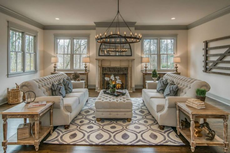 Check out this gorgeous living room reno by Millworks Designs. A great warm look with Momeni's stunning grey and white oval patterned area rug really tying the room together.