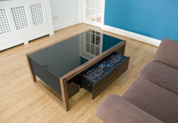 "One of several models from British company Surface Tension, the ""Arcane"" is the perfect high-tech coffee table choice for fans of vintage video gaming."