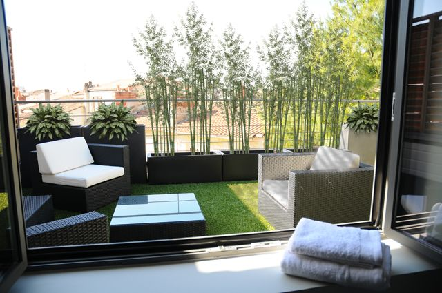 Terrace (yes, that's astro turf) in the Andy Warhol room at Villa Cosy, Bordeaux. Book now with Decanter Tours.