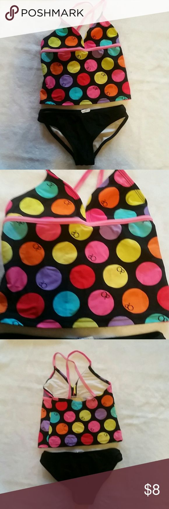 4/5 swimsuit Absolutely adorable 2 piece swimsuit. Solid black bottoms, top is black with multicolored polka dots. Such a cute big girl bikini, without showing much. Makes your little one feel like a big girl. No rips, holes, stains or tears. Swim Bikinis