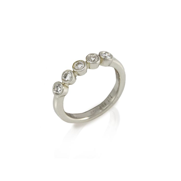 Embla five stone diamond ring  Beautifully simple 9 carat white gold ring with 5 tube set white diamonds (total 0,4 carats)