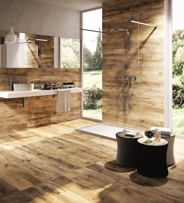 Ceramic tiles replicate wood in this modern bathroom. No fuss about cleaning and bound to make a statement with your guests!
