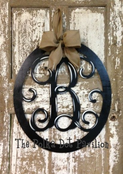 Oval Initial monogram wreath.  Would be perfect since we have ovaluar leaded glass in our front door.