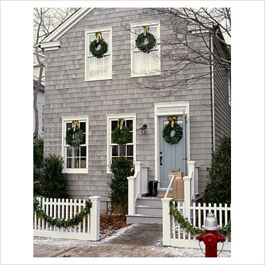 holiday curb appeal...I want to do this to my windows but do a burlap bow.