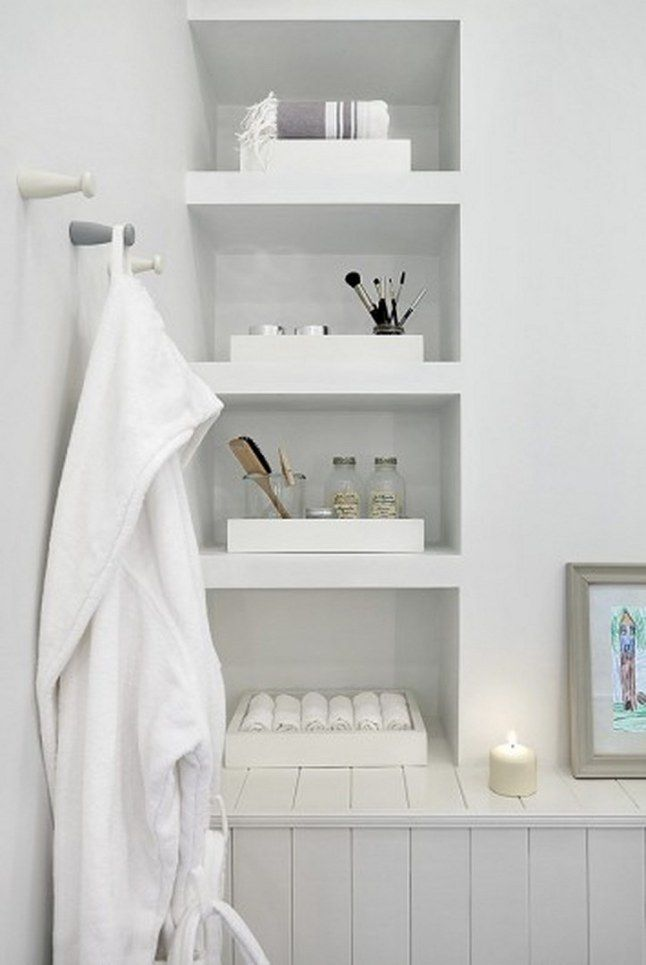 All white bathroom shelves for convenient storage