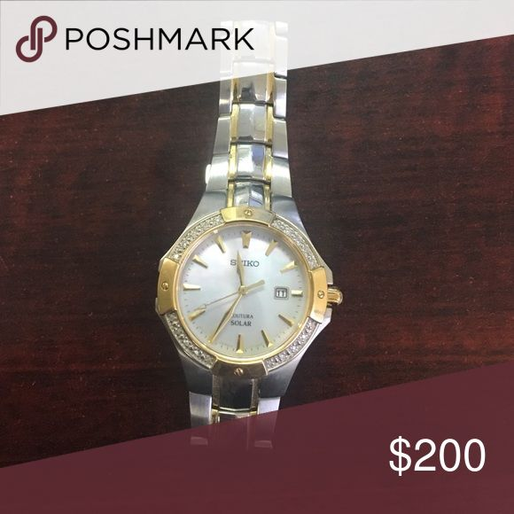 Women's seiko watch Gold and silver solar powered women's seiko watch, hardly worn, was $500+ will take $200 OR BEST OFFER. Please feel free to make offers! Seiko Accessories Watches