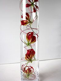 Tropical Wedding Centerpiece - Flame Lillie's - the national flower of Zimbabwe, perfect for me!!!