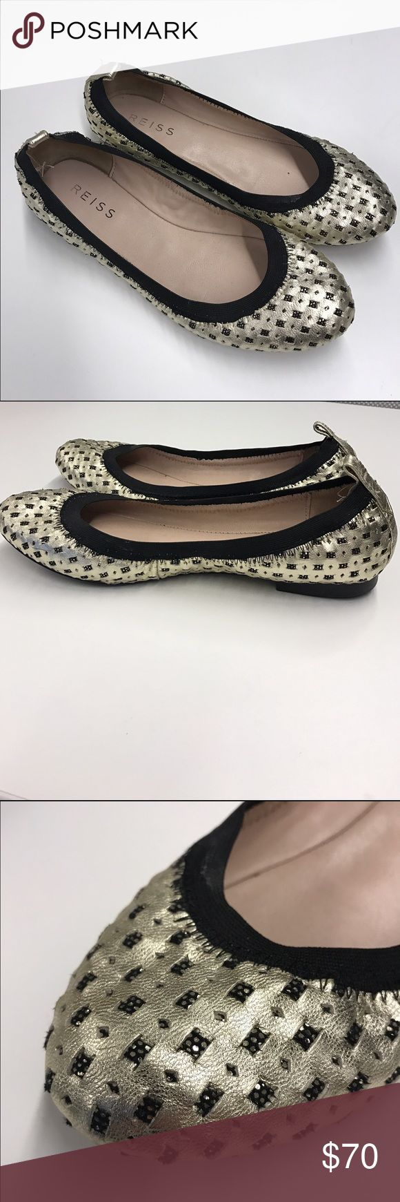 REISS Gold Flats Reiss gold flats. Designed with a softly padded sole that has comfort at its core, the gold flat shoes are a beautifully wearable option that work both in the office and on the weekend. They have a soft elastic black band around the foot and gold sparkle details that adds a touch of shine to the look.                                                  🌟 Offers accepted!                                               🌟 Bundles accepted…