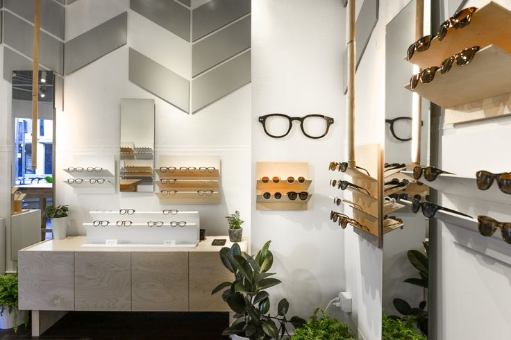 Modern Optometry practice. Decor includes chevron wall panelling and frames cut out wall art.