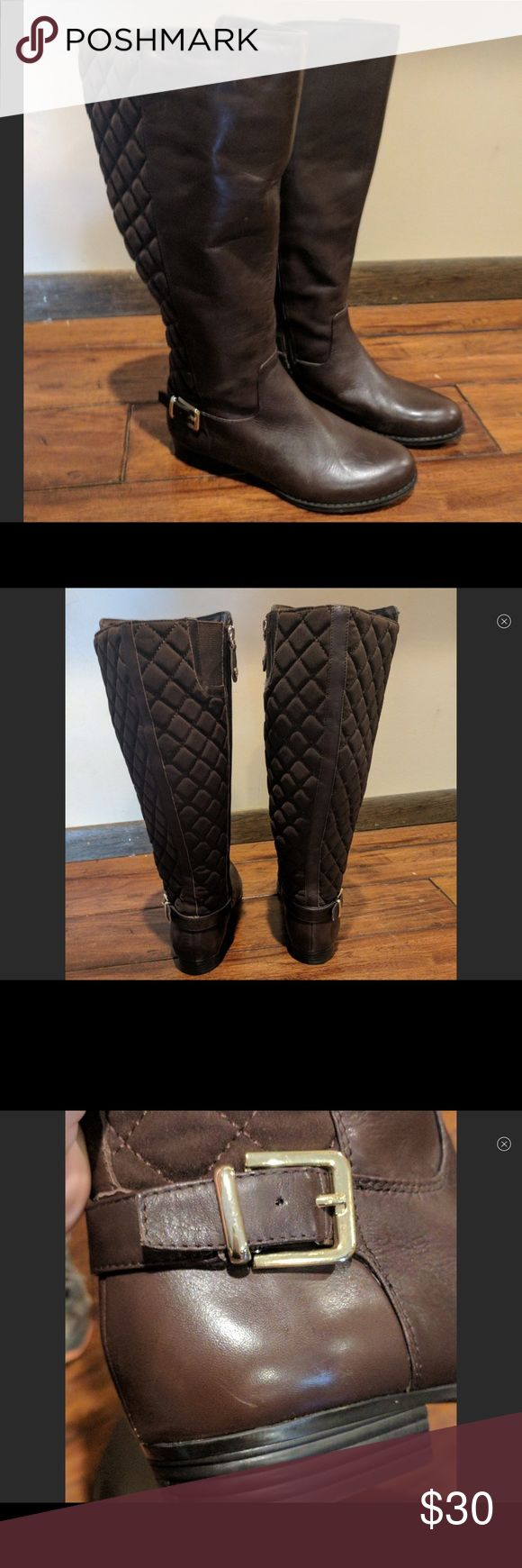 """Isaac Mizrahi Quilted Riding Boots Wide With chic quilted textile detail on the back, these boots make anything you're wearing that much more fabulous. Riding boot style; tall shaft with quilted textile detail on back; goldtone faux buckle hardware detail on outside of shaft; side-entry zipper closure Approximate measurements: Heel 1""""H; Shaft 15-1/2""""H; Wide calf circumference 17""""-18"""" These were purchased new on poshmark and worn once and are too big for me, I fluctuate brands/sizes. These…"""