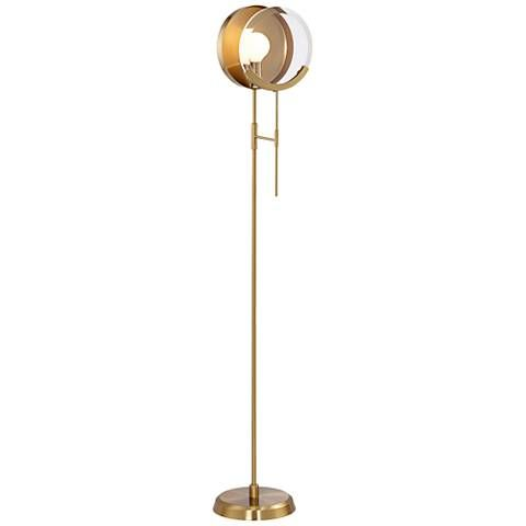 A magnifying glass-style accent is mounted in front of the single bulb in this decorative contemporary antique brass floor lamp.
