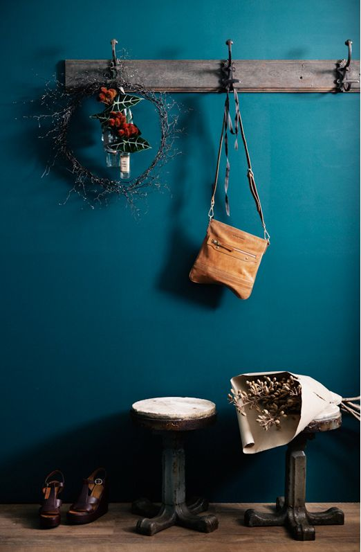 """Teal wall """"drop space"""". Get organized with hooks in the front hallway."""