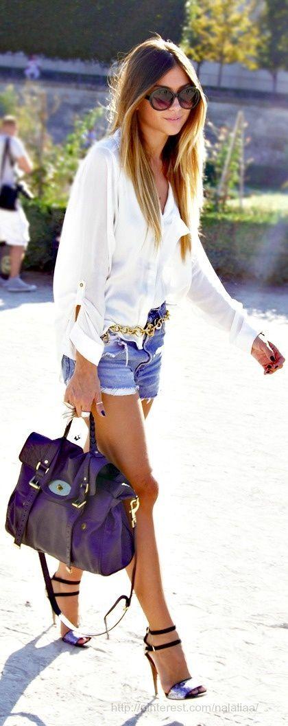 White loose shirt, jean shorts, purple hand bag and high ...