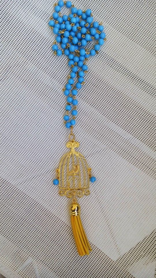 Handmade long necklace with turquoise pearls by Elli lyraraki