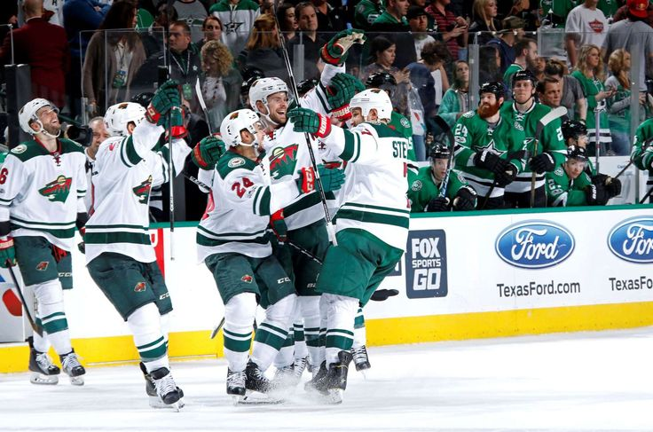 Wild finish:   Chris Stewart, right, of the Minnesota Wild is congratulated by his teammates on a game‐winning shootout goal against the Dallas Stars on Jan. 24 at the American Airlines Center in Dallas. The Wild won 3‐2.
