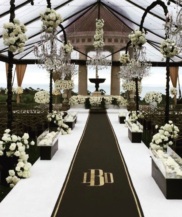 Elegant Outdoor Ceremony, Gold & Black Aisle Runner with Monogram | Photo: Courtesy of The Original Runner Company.