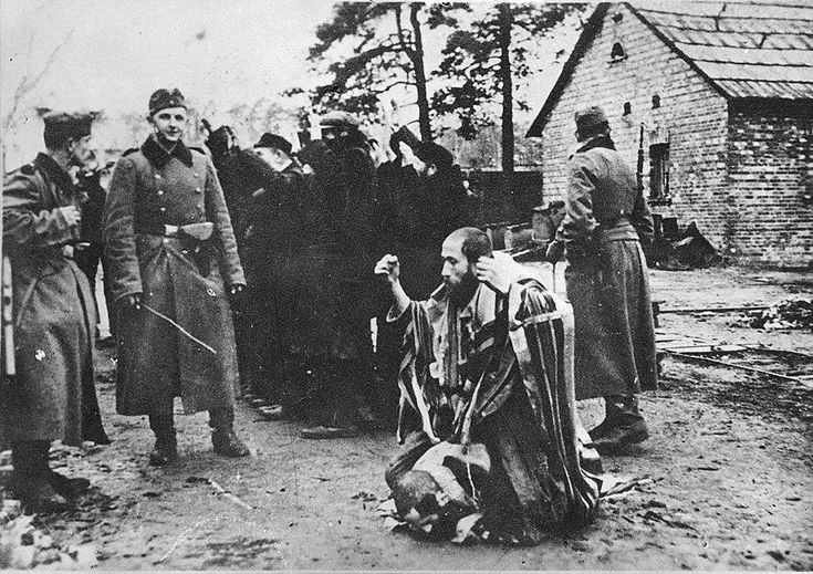 """""""This man, kneeling down before the Nazis, was my grandfather just before he was murdered. I look at this picture every day and promise that the Holocaust will never happen again."""" - Meir Dagan (1945-2016)."""