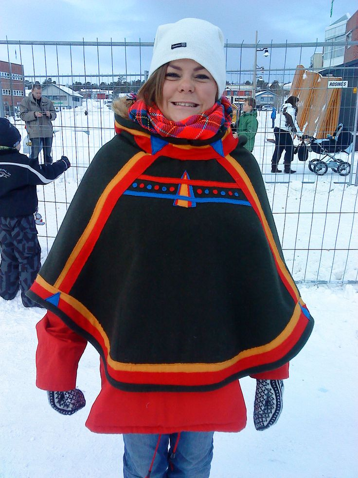 Luhkka - I do like these colorful ones. And I like how she's wearing it as it is meant to be worn—over your regular coat, to protect from snow. <3