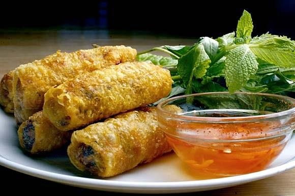 Traditional Vietnamese spring rolls. Fun fact: originally made for royalty, hence the nickname 'Imperial Rolls'.