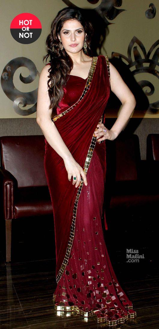 Zarine Khan wears a maroon sari from designer Archana Kocchar for a jewellery launch.