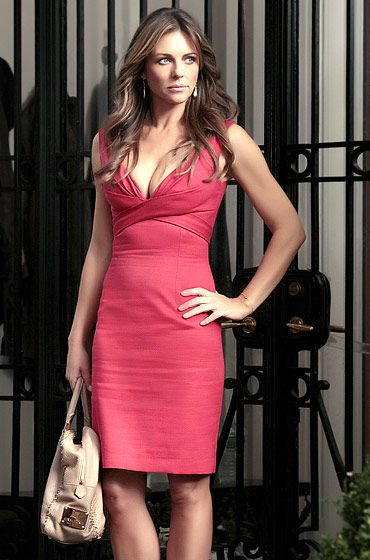 """Season 5, Episode 2: """"Beauty and the Feast""""  0 .  Diana Payne (Elizabeth Hurley) sizzled wearing an Alexander McQueen dress and an Analeena bag."""