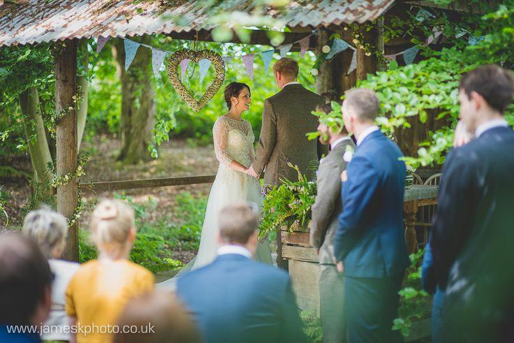 Bride & Groom. Wedding Ceremony. Bunting. Hush Venues Norfolk Outdoor Wedding Venue. Wedding in the woods. Norfolk Wedding Photographer. www.jameskphoto.co.uk