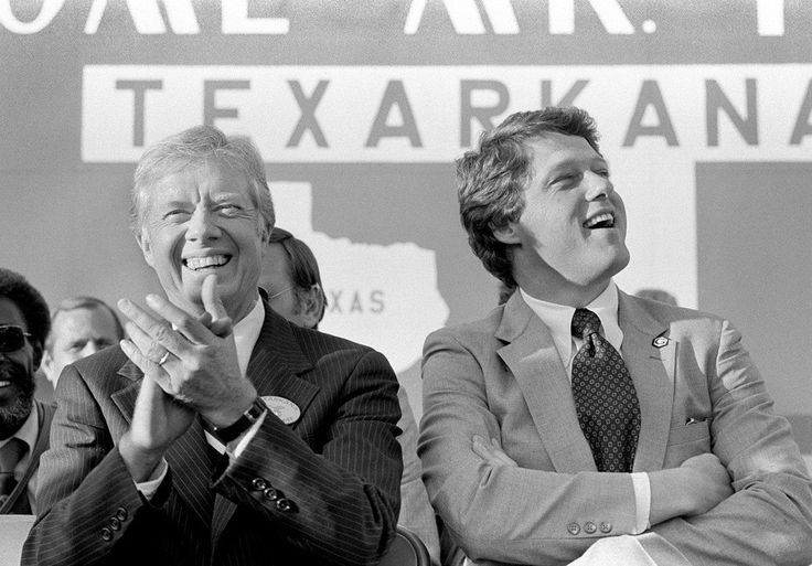 During an Oct. 22, 1980, rally on the Texas-Arkansas border, President Jimmy Carter is joined by Arkansas Gov. Bill Clinton. Texarkana was the last stop for Carter on a three-city one-day campaign swing through Texas.