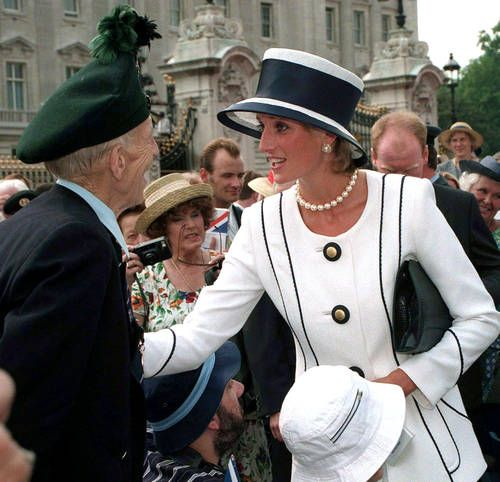HRH Diana, Princess of Wales wore a navy and white suit by Tomasz Starzewsk and white hat trimmed with a wide navy band by Philip Somerville in 1994.