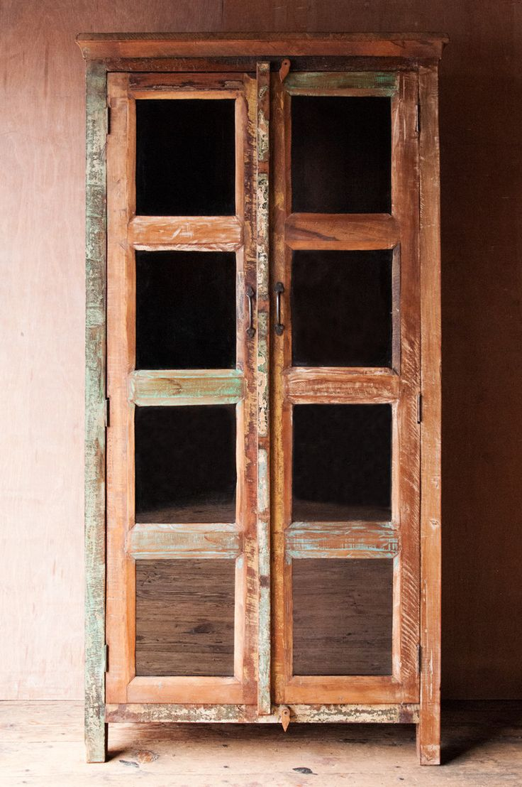 The green and cream hues, and distressed patina of this recycled wood and glass hutch are subtly handsome Reminiscent of old farm house cabinets with it's simple, classic lines and worn exterior, this