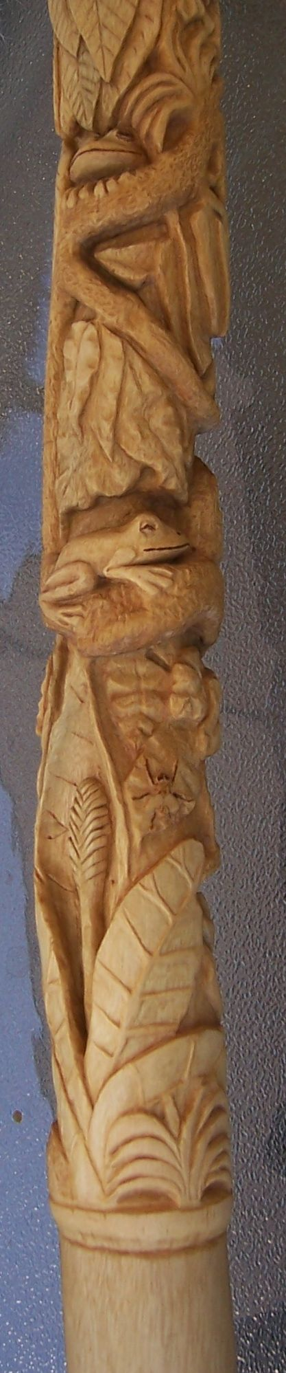 The Rainforest - a hand carved walking stick on Sycamore. tree frog, fly, flower