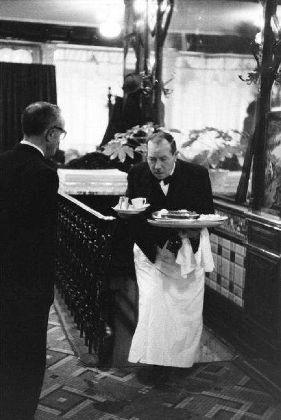 Garçon au café Les Deux Magots, Paris, 1957 • Janine Niepce