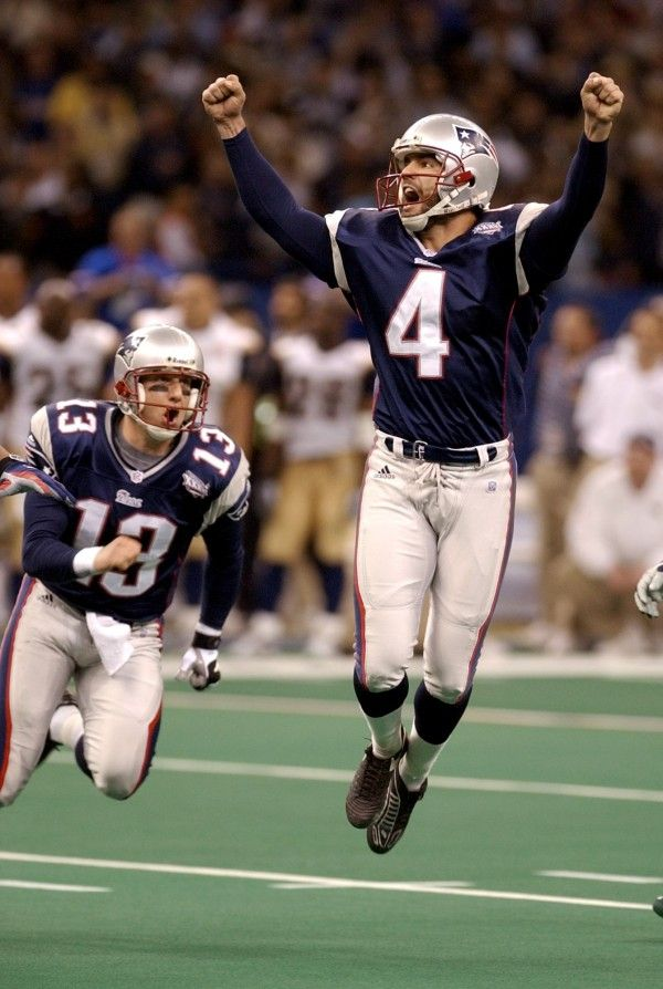 New England Patriots' kicker Adam Vinatieri celebrates his 48-yard game-winning field goal in the final seconds of Super Bowl XXXVI against the St. Louis Rams Sunday, Feb. 3, 2002, in New Orleans. At left is teammate Ken Walters.