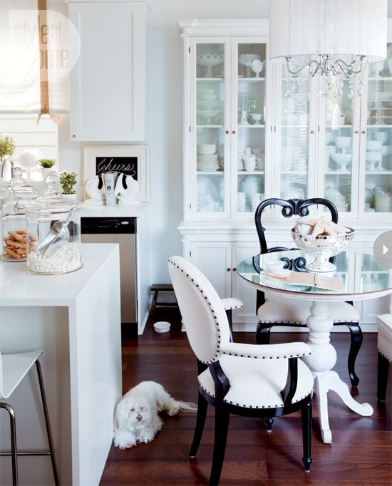 mirrored pedestal table + black & white chairs