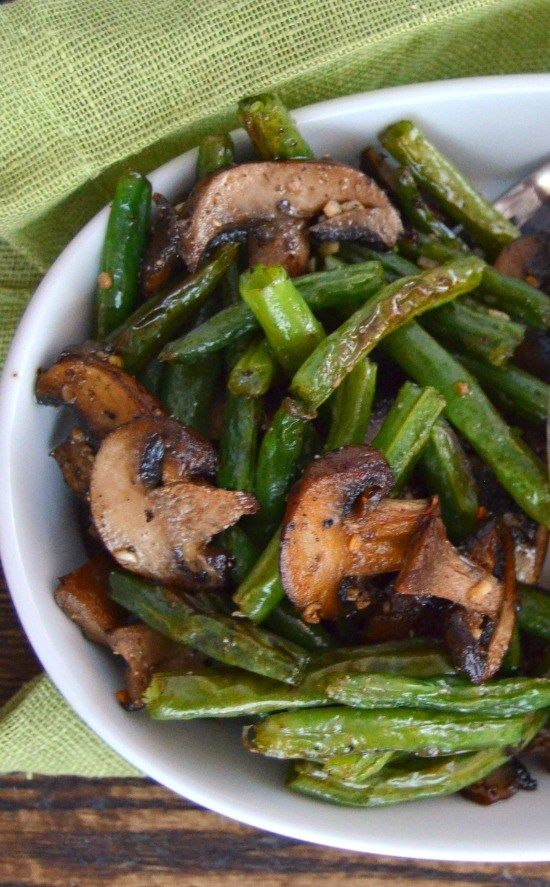 This recipe for garlic roasted green beans and mushrooms is simple and quick! Healthy roasted vegetables make the perfect side dish.