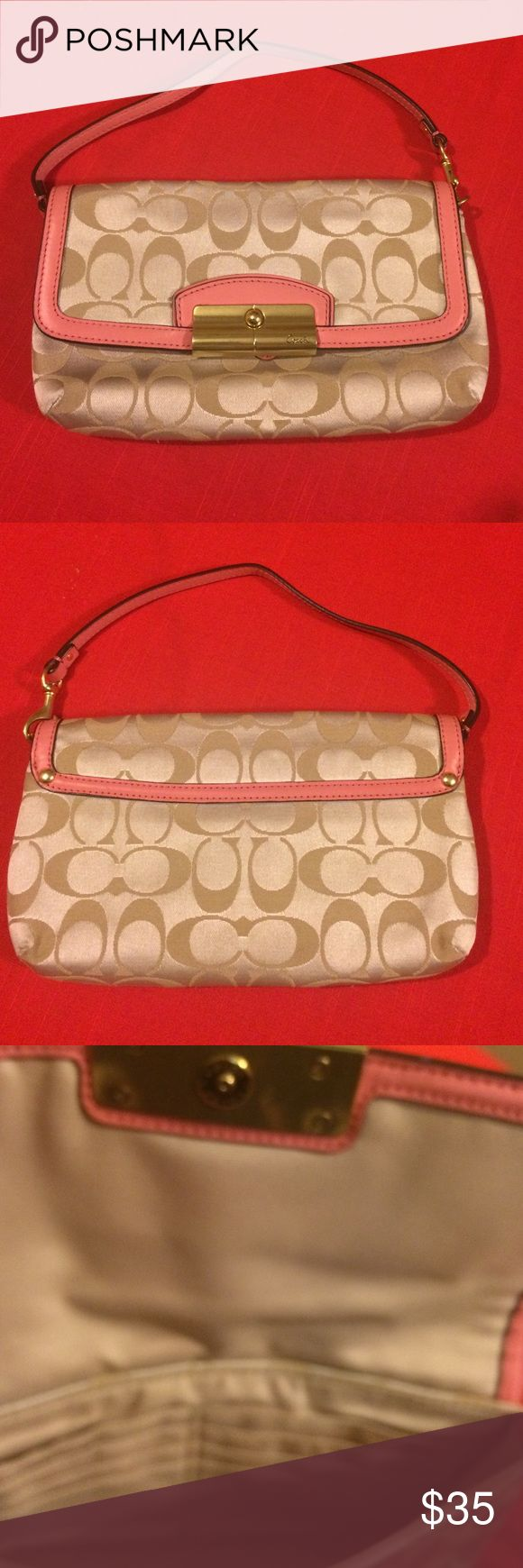 EUC, very cute Coach clutch , light tan fabric EUC, very cute Coach clutch , light tan fabric w/pink leather trim, carried a couple times, but in great condition . Coach Bags Clutches & Wristlets