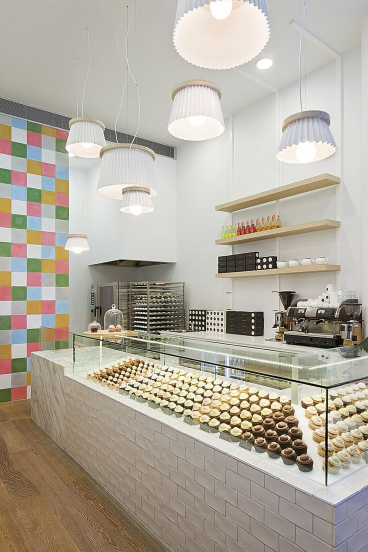 modern interior design, marie yates, retail, ...it's cupcake store get it? Look at the lights... Makes me smile...elegant and clever and not too full of itself bravo!