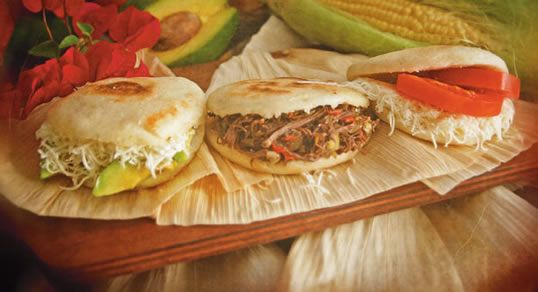 Arepa...The most popular dish in Venezuela! Is a dish made of ground corn dough or cooked flour. which can be grilled, baked, boiled, or fried. The characteristics vary by color, flavor, size, thickness, garnishment, and the food with which it may be stuffed, depending on the region.