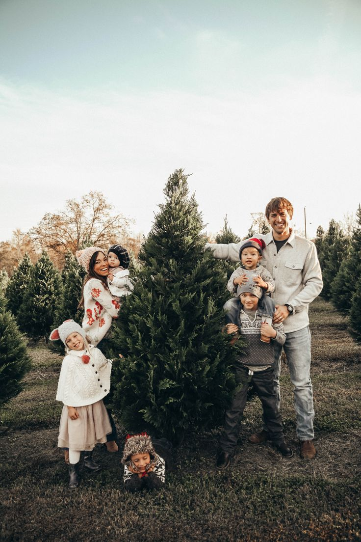 A family that cuts down the xmas tree together...is a family with love!!! Evie & Adrienne || Sustainable Baby Clothing and Accessories || Made in America || Be The Good || Fertility Awareness || www.evieandadrienne.com (original post) family