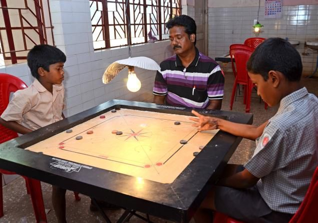 School students taking part in the district-level carrom tournament in Tiruchi on Friday. Photo: R.M. Rajarathinam