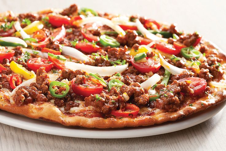 Gourmet - Mexicana. Hot and spicy! Bolognaise mince, cherry tomatoes, assorted peppers, onions, garlic and chilli | Panarottis http://www.panarottis.co.za/ourmenu/pizza